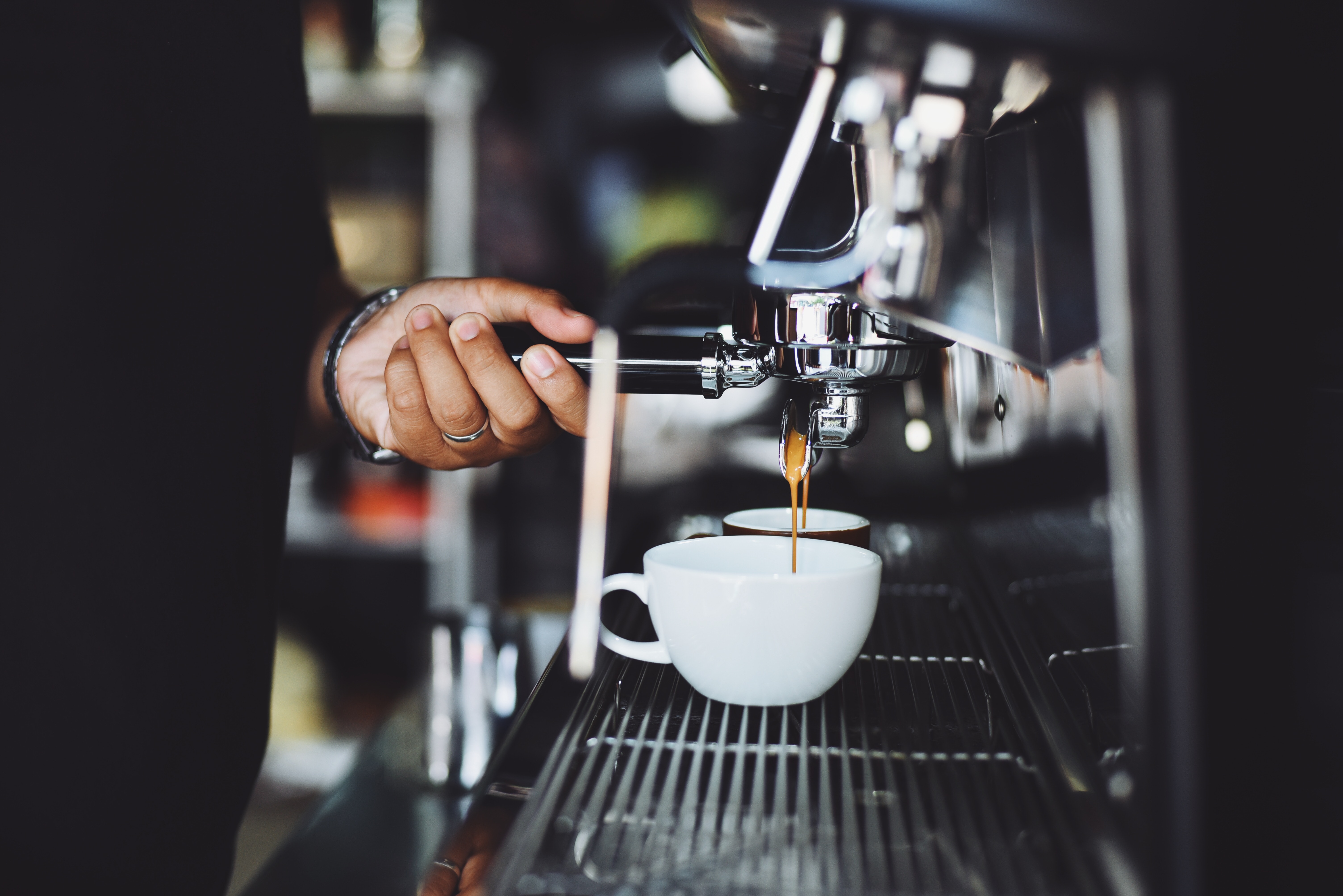 close-up-of-hand-holding-coffee-cup-302902
